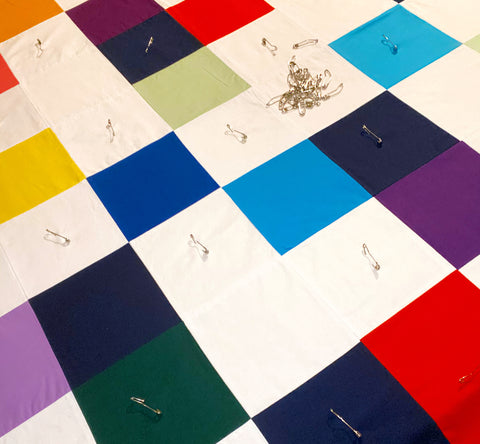 quilt getting basted with safety pins