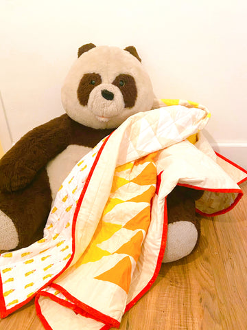 big stuffed panda teddy bear with handmade quilt