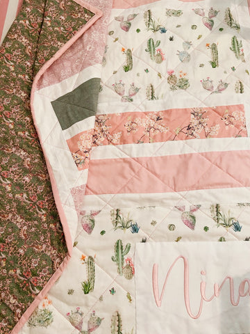 baby girl quilt with greens and pinks