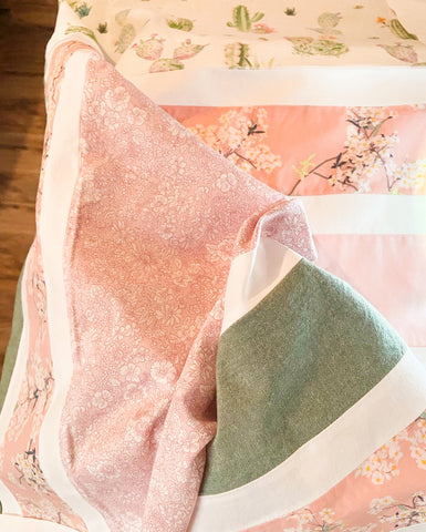 pink and green floral baby quilt top