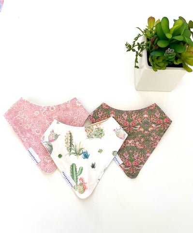baby girl bib set with floral fabrics in pinks and greens