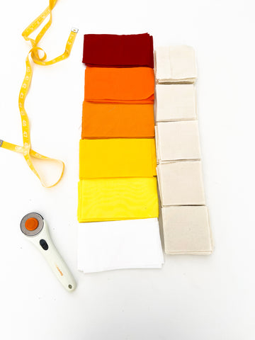 color palette for baby quilt with red, orange, yellow, white, and cream