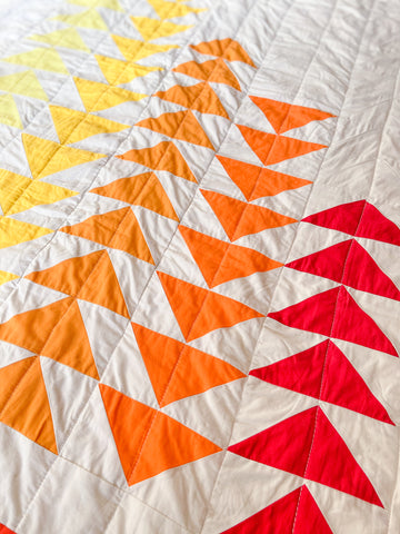 flying geese in ombre on baby quilt