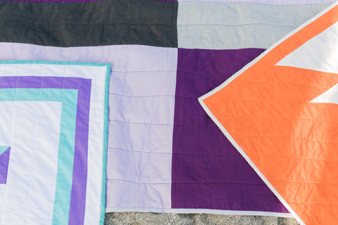 three kids quilts laying on top of each other