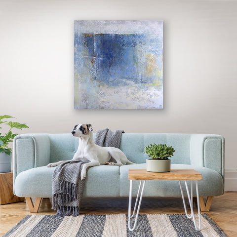 Precipice abstract painting over sofa with cute dog