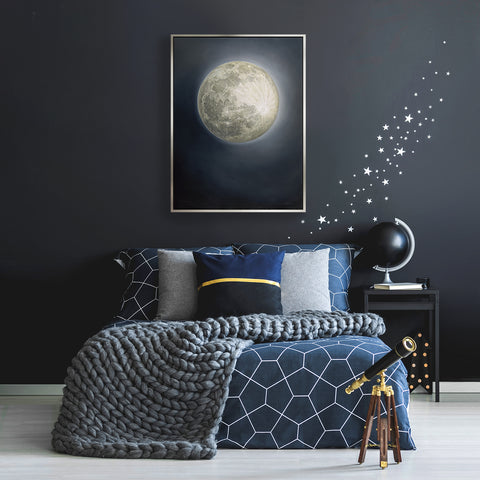 Snow Moon painting hanging over bed