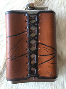 Leather wrapped flask with buffalo