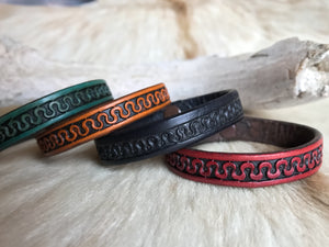 Half inch leather bracelet with serpentine pattern