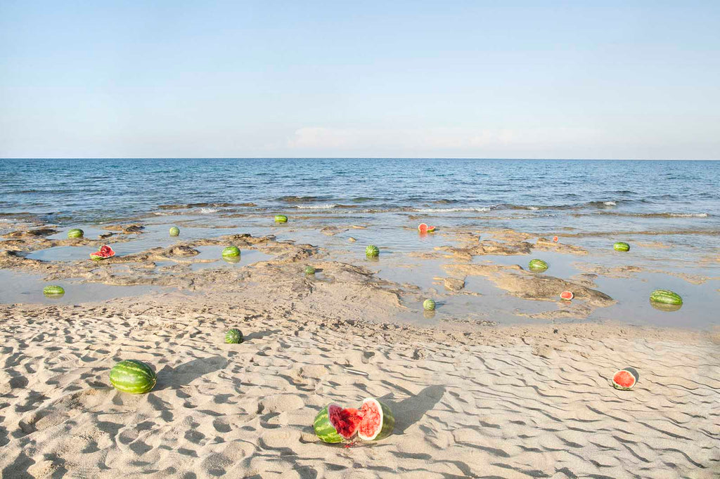 ALESSIA ROLLO Fata Morgana project, shoot in Salento (Apulia, Italy) in 2015 I set up a picture with many watermelons to speak in a metaphoric way about migration.