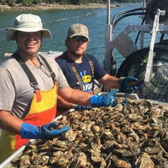 John's River Maine Oyster Farmers on Boat with Fresh Oysters