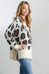 Umgee Cream Animal Print Sweater with Distressed Hem