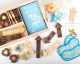 A top view of the wooden puzzle pieces, blindfolds, and map which make up the The Empathy Toy Teacher's Kit for play-based learning.