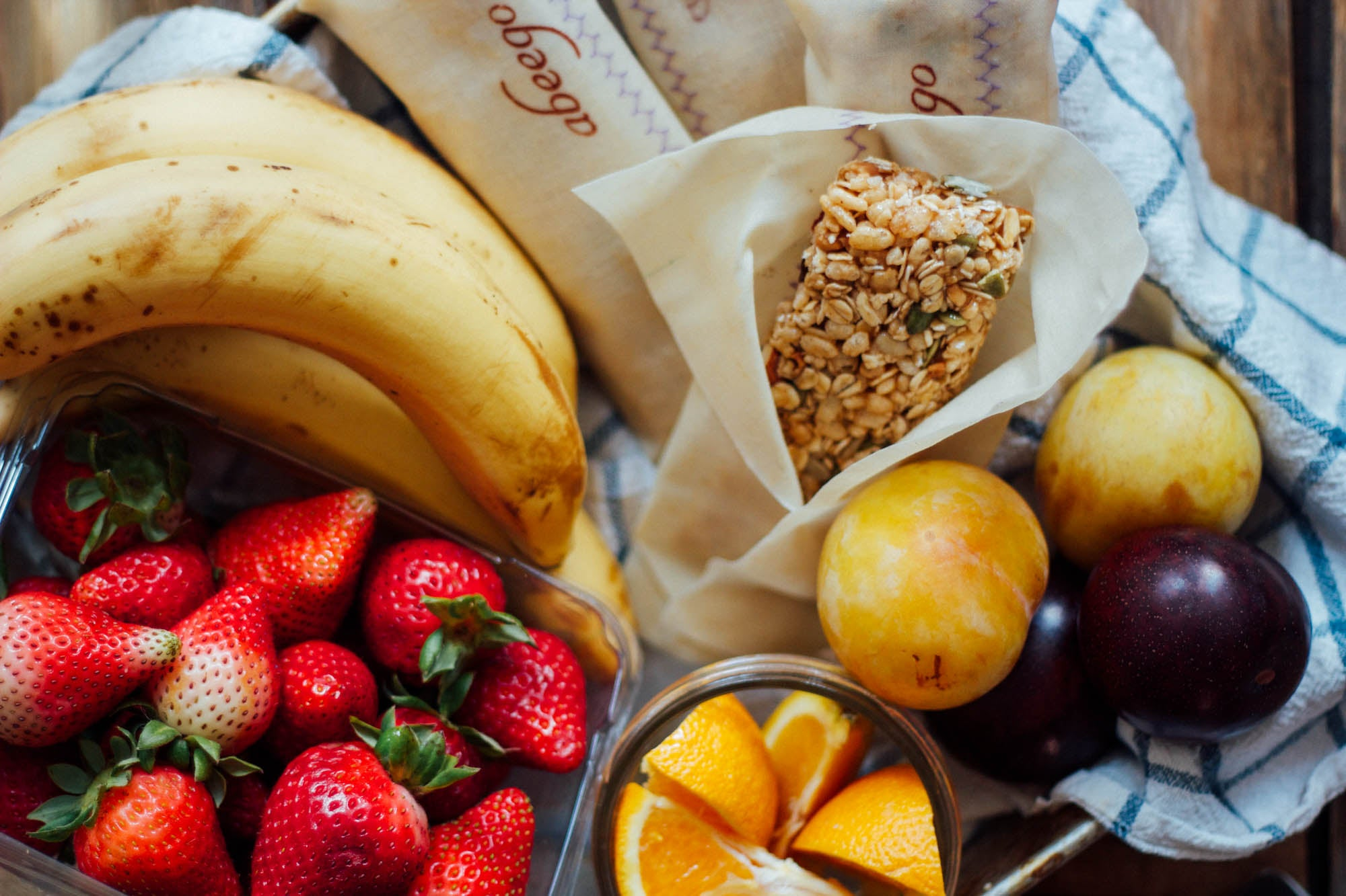fresh fruit with healthy granola bars wrapped in beeswax wrap