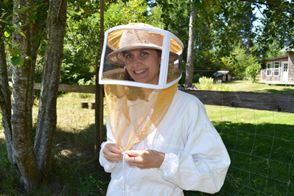 Toni in bee keeper suit