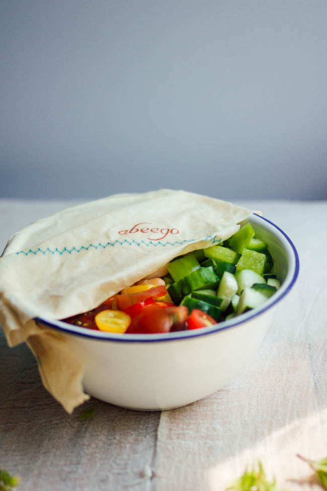 bowl of salad covered with reusable beeswax food wrap