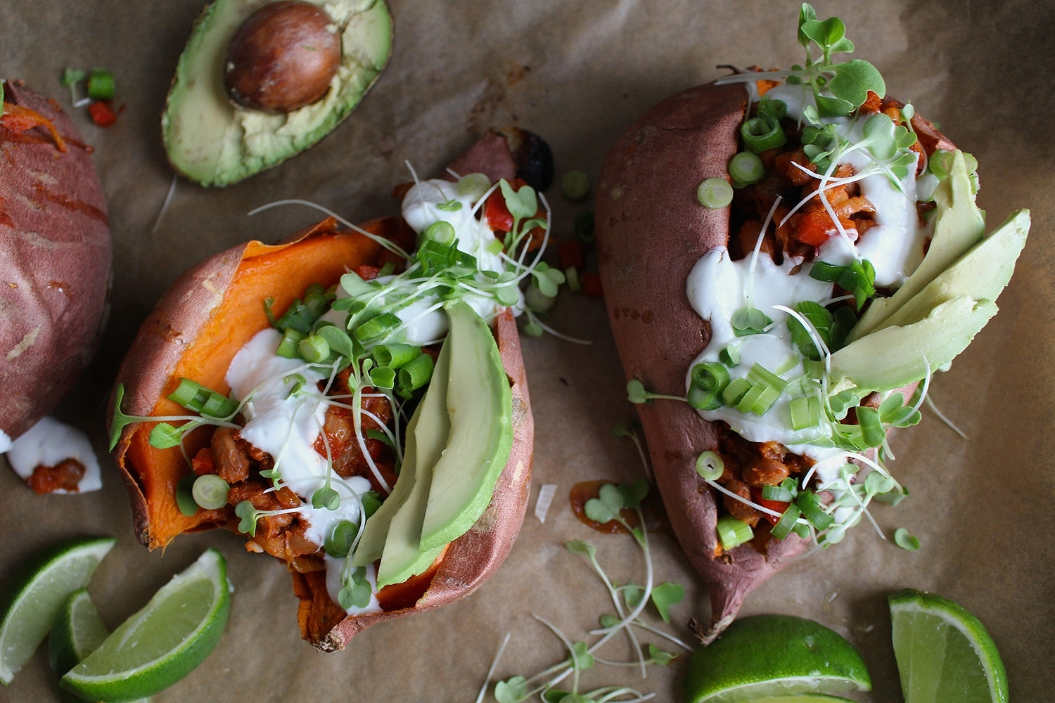 Stuffed sweet potatoes with sour cream, avocados, sprouts