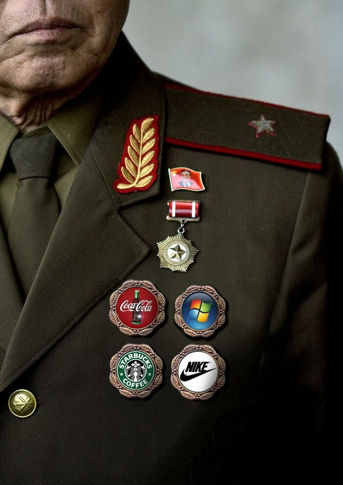 A few different logos on a soldier's uniform