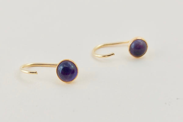 The gold j hook earrings with the amethyst gemstone