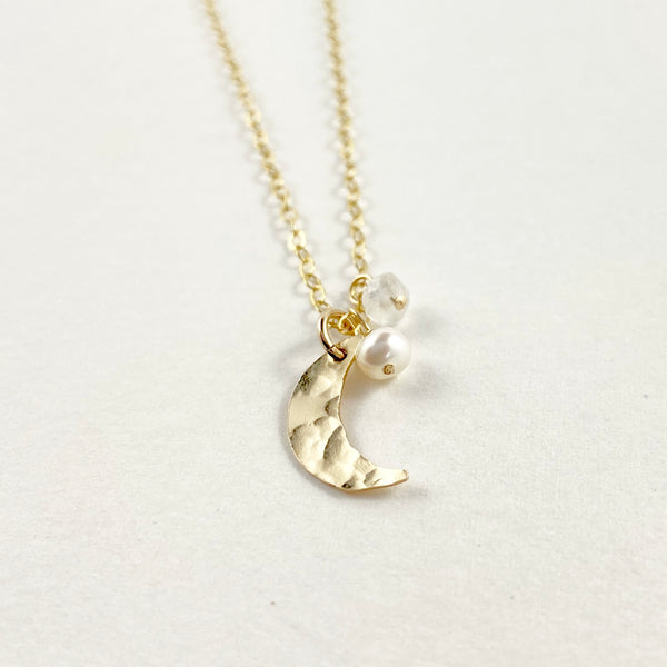 A closeup look of the small moon pearl dreamer necklace