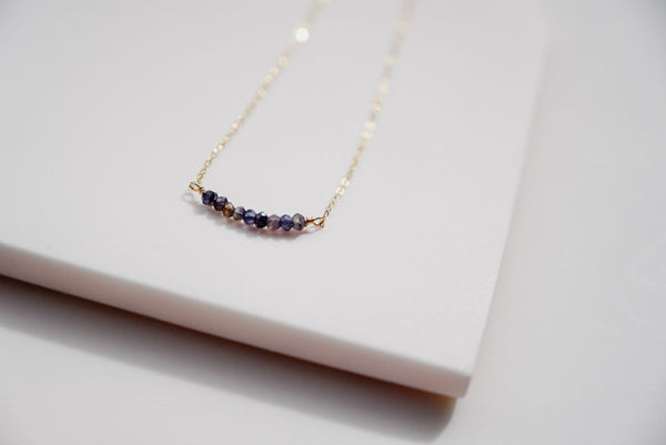 The gold strand gem necklace with iolite