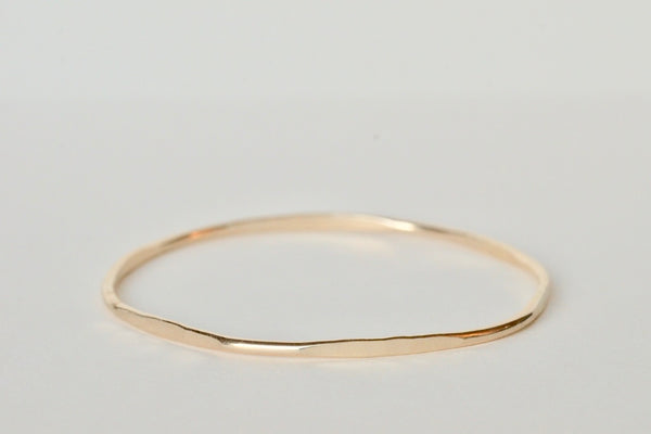 The gold hex bangle