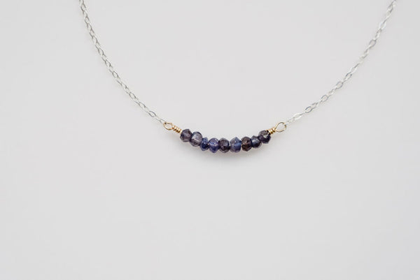 The silver strand gemstone necklace with iolite stones