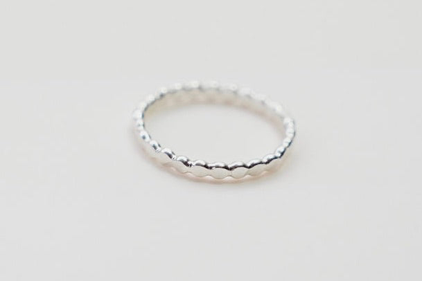Our simple silver flat ball stacking ring