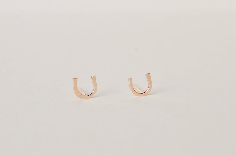 Our pair of gold Horseshoe studs