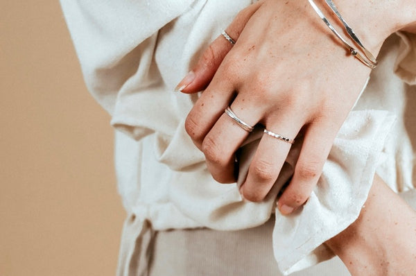 Our model wearing the silver meditation ring on her middle finger