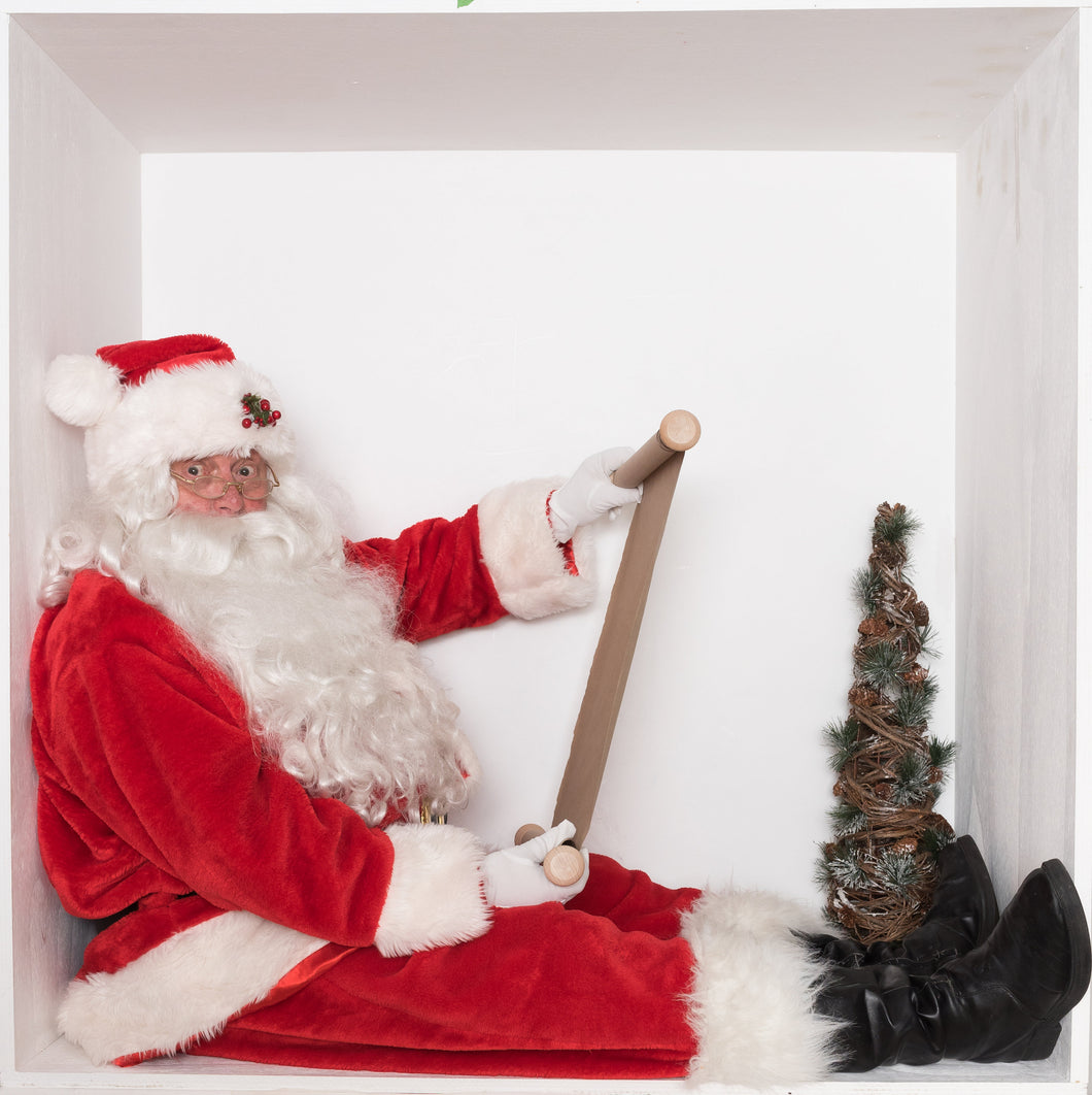 Santa in the box SURPRISED checking his List