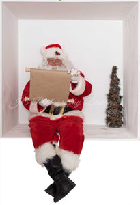 Santa In the box Checking his list
