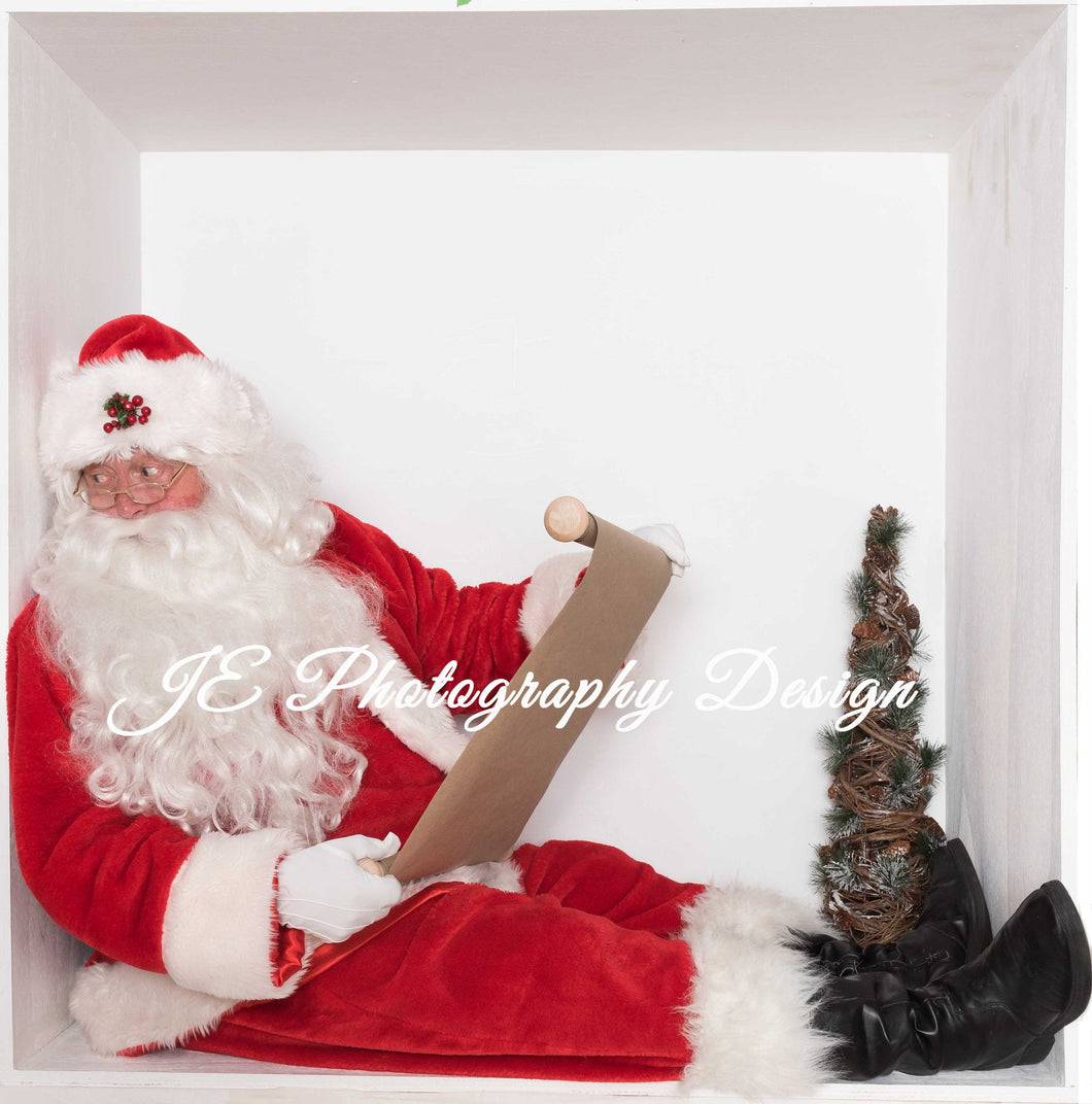 Santa in the box Checking his list and looking