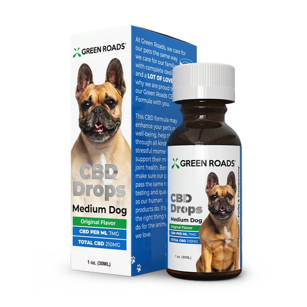 Small brown bottle of CBD with image of dog on it
