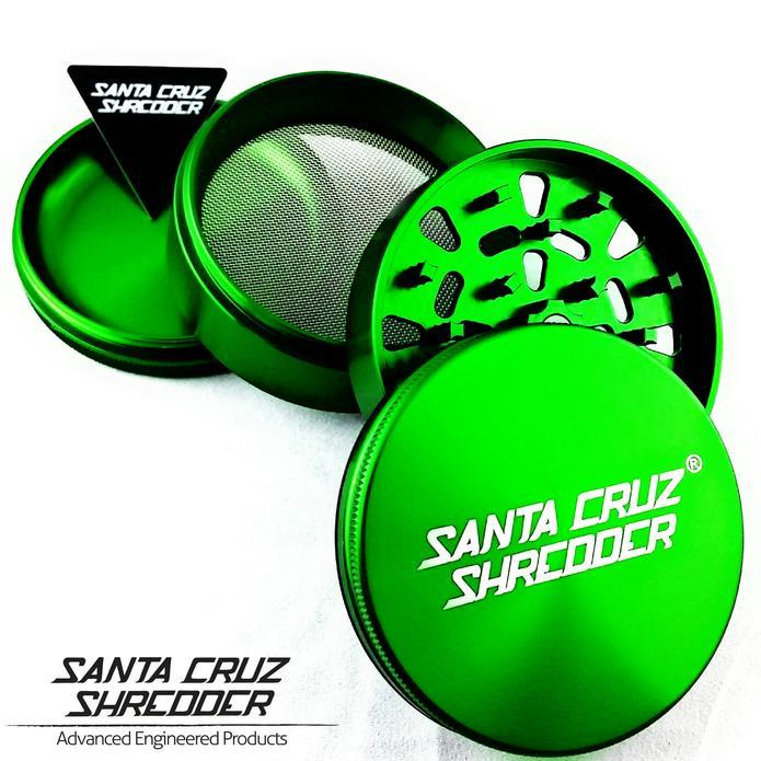 Bright green grinder displayed in four pieces