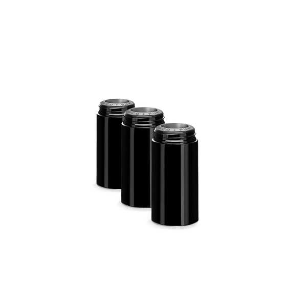 Group of three black ceramic tubes in line