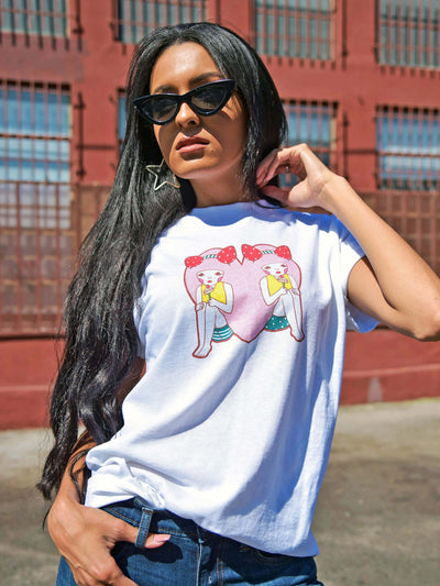 White graphic tee with kawaii heart girls by Los Angeles artist Naoshi.