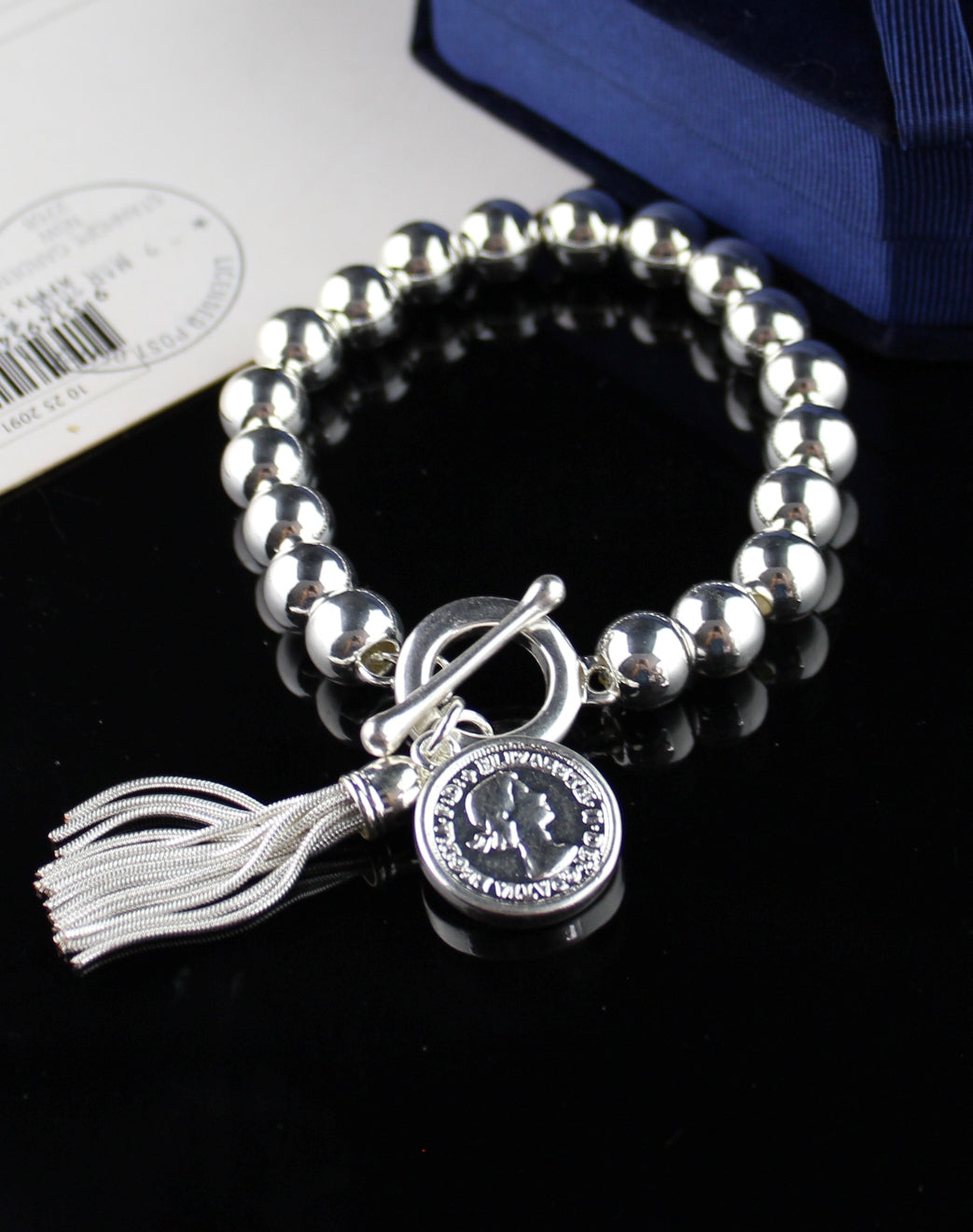 Silver Bracelet with Coin Tassel