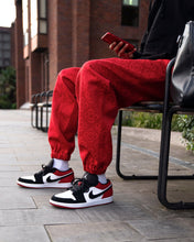Load image into Gallery viewer, Patterned 'Red Q' Pair - [Pairs UK] [jogging bottoms] [ are those pairs] [mike pairs] [sweatpants] [patterned sweatpants] [patterned pants]