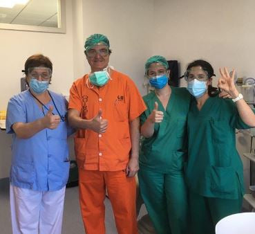 Doctors and nurses wearing surgical mask and goggles