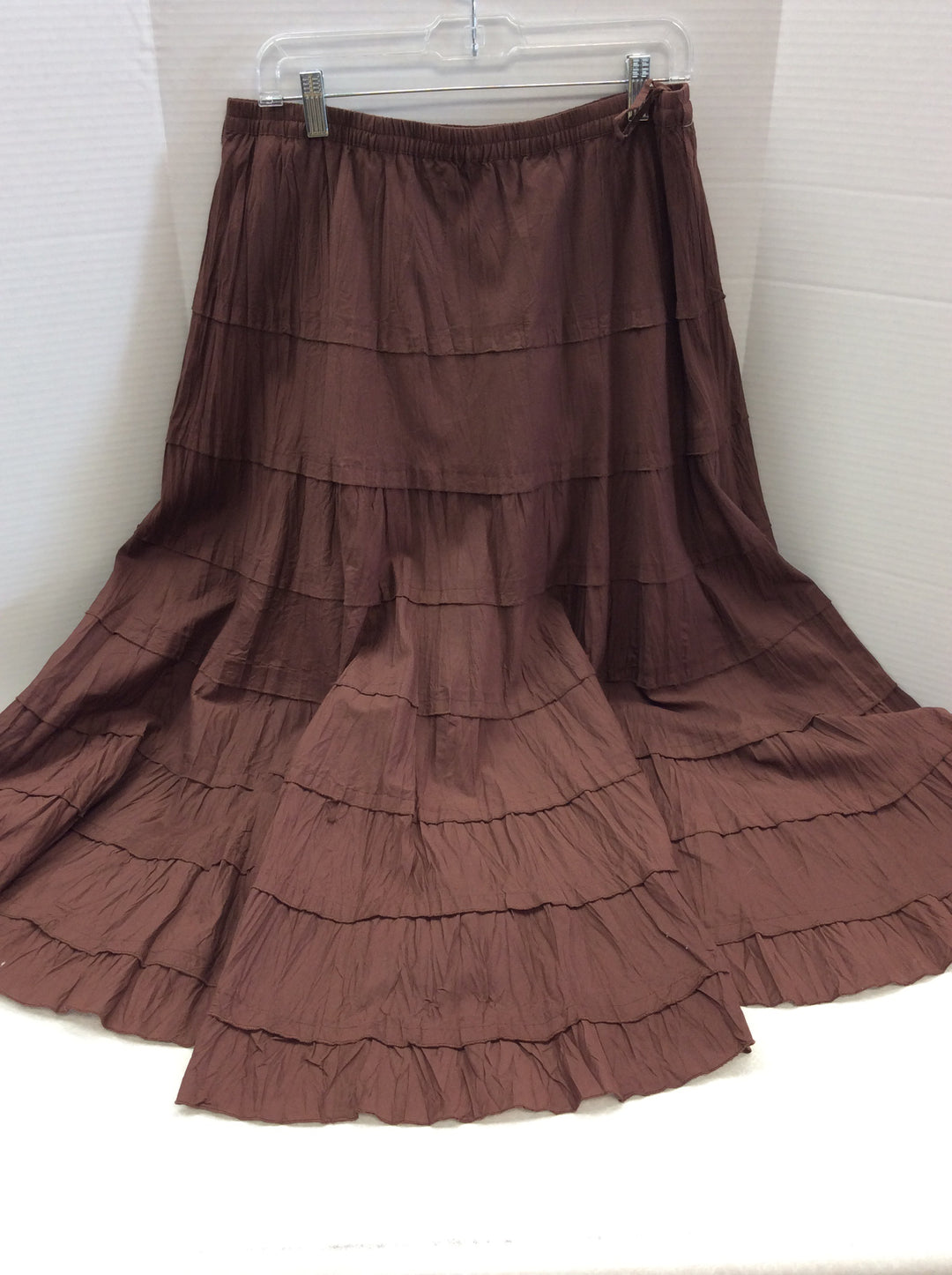 Primary Photo - BRAND: MULTIPLES <BR>STYLE: SKIRT <BR>COLOR: BROWN <BR>SIZE: L <BR>SKU: 133-13374-1621<BR>BEAUTIFUL FULL RUSTY BROWN SKIRT. LOOKS GREAT WITH BOOTS! SEE IT STYLED IN LAST PHOTOS ( ITEMS IN THE STYLES PHOTS ARE SOLD SEPARATELY AND ARE NOT INCLUDED IN THE SALE OF THE SKIRT)