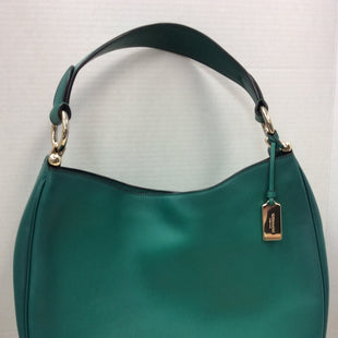 Primary Photo - BRAND: COACH STYLE: HANDBAG DESIGNER COLOR: GREEN SIZE: LARGE OTHER INFO: NOMAD MAE BURNISHED LEATHER SKU: 133-13371-13570THIS HANDBAG IS IN GOOD USED CONDITION. IT DOES HAVE SLIGHT SCRATCHING  AND SOME WEAR ON THE GOLD HARDWARE RINGS THAT HOLD THE STRAP AS SHOWN IN PHOTOS, BUT IT IS A BEAUTIFUL GREEN COACH HANDBAG!