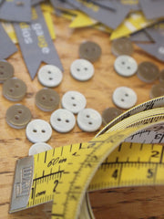 Labels, tape measure and buttons