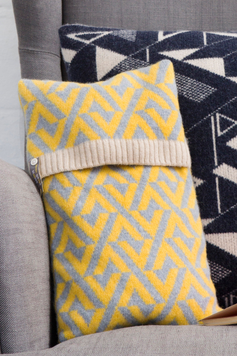 Geo lambswool knitted hot water bottle in yellow and grey
