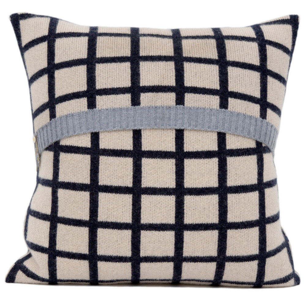 Grid knitted cushion in dark blue and cream
