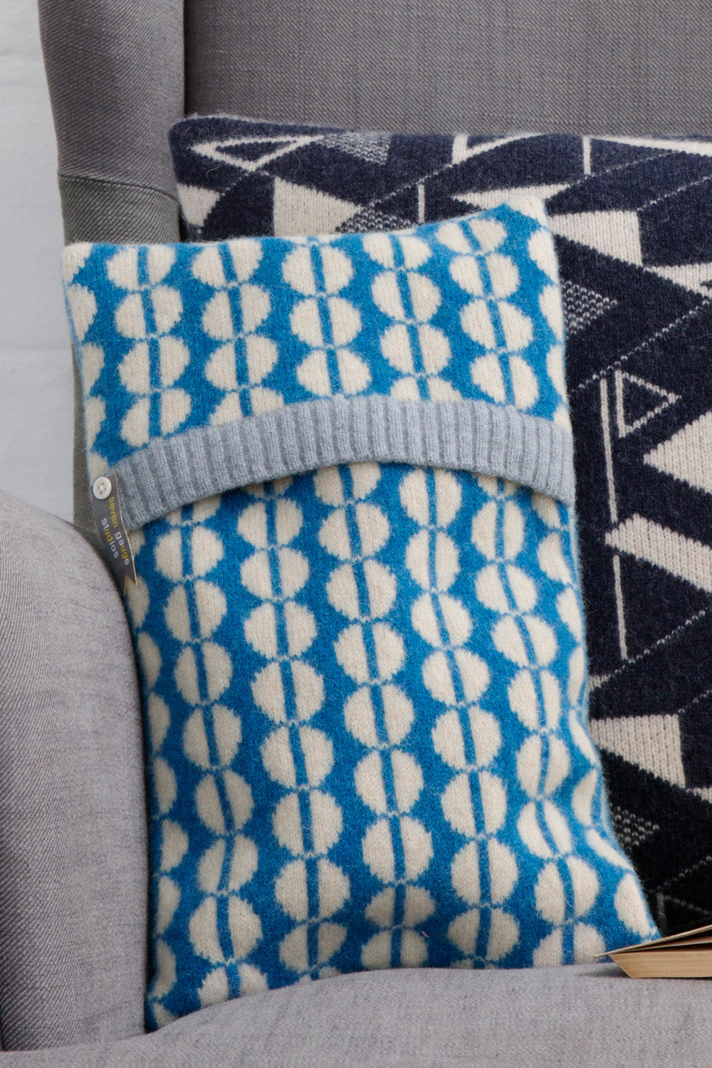 Spot lambswool knitted hot water bottle in oatmeal and blue