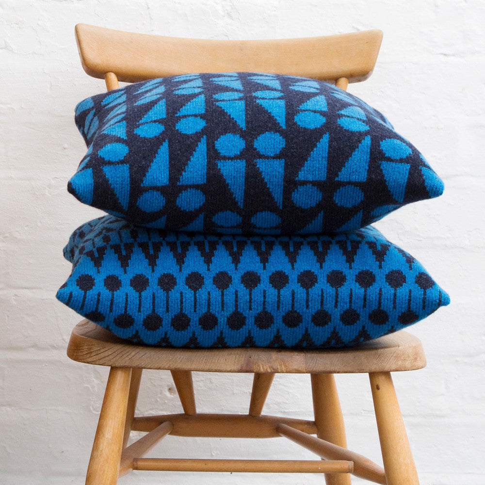 Folk knitted cushion in dark indigo and blue