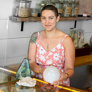 Lou Laplant holding a crystal while smiling