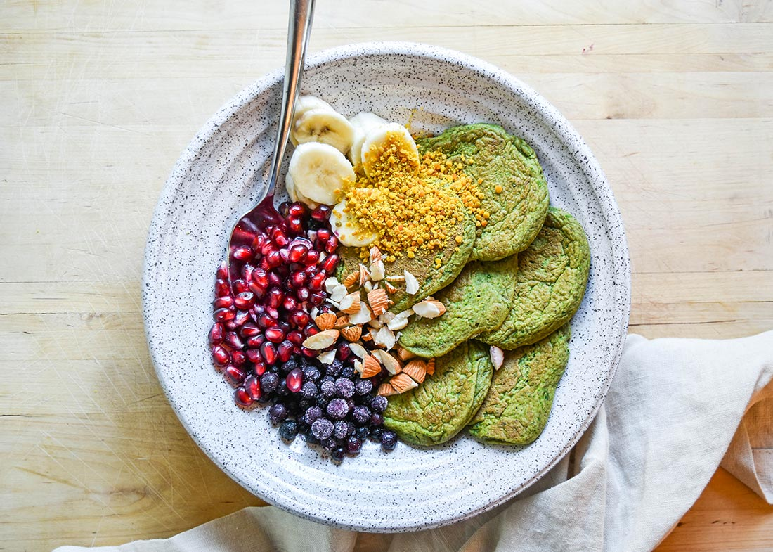 Green pancakes with fruit