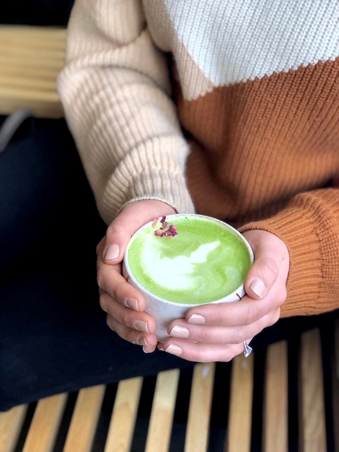 Hands holding a cup of matcha
