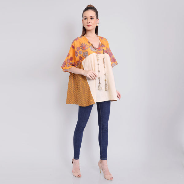 Godet top with mixed prints